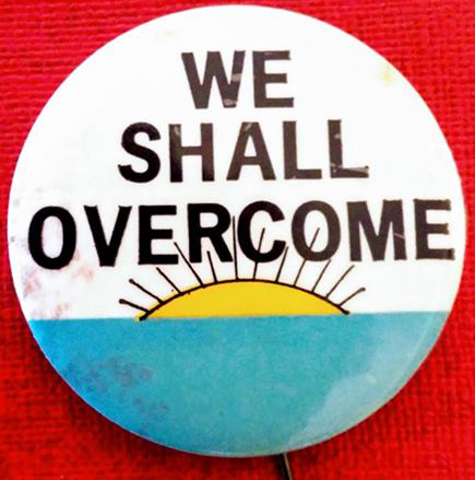 [We Shall Overcome pin with sun motif]